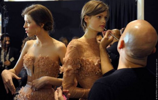 Swiss model Julia Saner is made up backstage before Lebanese designer Elie Saab fashion show during the Haute Couture fashion week in Paris